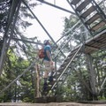 Reaching the base of the fire tower at Snowy Mountain's summit.- Adirondack Fire Tower Hikes