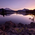The welcoming warming glow of sunrise over Sparks Lake in Three Sisters Wilderness.- Wander Among Wilderness Areas