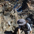 A hiker navigates a short third-class section on Mount Superior. - Making Headway on the Wasatch's Mountain Accord