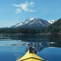 The reflection of Mount Tallac (9,738 ft) in Lake Tahoe's blue water.- Paddling the West