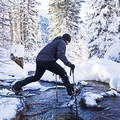 Crossing a stream at Tanners Flat.- 26 Amazing Snowshoe-to-Waterfall Adventures