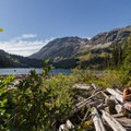 Taking a break along Tenquille Lake.- Tenquille Lake Hike via Tenquille Creek Trail