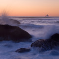 Tillamook Rock Lighthouse in the distance from Indian Beach at sunset.- Ecola State Park