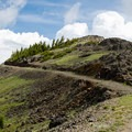 Bald peaks and cut trails on the way to Dunraven Pass.- Mount Washburn via Dunraven Pass