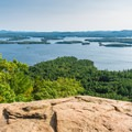 Panoramic view of Squam Lake from the overlook of Wes Rattlesnake Mountain.- New Hampshire's Best Lakes for Summer Adventure