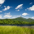 The easy half-mile trail to Connery Pond rewards hikers with stunning views of Whiteface Mountain.- A Winter Adventure Weekend in Lake Placid, New York