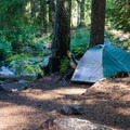 Tent spot by the creek in White River Falls Campground.- Great Camping Near the Enchantments