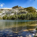 Wading into Cathedral Lakes.- Cathedral Lakes Trail