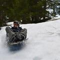 Heading down the mile marker 75 sledding hill.- Best Winter Adventure Destinations