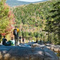 Couples and families taking a break above the Zealand Falls.- Incredible Adventures in New Hampshire's White Mountain National Forest