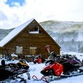 Snowmobiles Outside of Burgdorf Hot Springs. Photo courtesy of McCall Area Chamber of Commerce.- 7 McCall Hot Springs To Soak Your Troubles Away