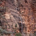 A large waterfall caused by a rainstorm earlier in the day.- Angels Landing Hike