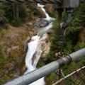 Suspension bridge supports with waterfalls in the distance- Lava Canyon