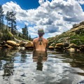 Taking a soak before the afternoon thunderstorms roll in.- Jordan Hot Springs via Blackrock Trailhead
