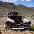 Rustic cars on display in the desert.- Eureka Mine + Aguereberry Camp