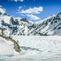 Sawtooth Lake still frozen in late June.- Alpine + Sawtooth Lakes, Iron Creek Drainage
