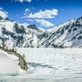 Sawtooth Lake still frozen in late June.- Alpine + Sawtooth Lakes, Iron Creek Drainage