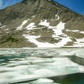 Ice breaking up in Goat Lake with Standhope Peak behind.- Broad Canyon: Betty, Goat + Baptie Lakes and the Surprise Valley Divide