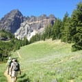 Trekking through the meadow to the glacier tarn area- Canyon Creek Meadows
