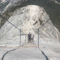 Cables from the top of Half Dome. Its a steep climb. BRING GLOVES. Best gloves to get are the light weight ones with the rubber hands and cloth on the back.- Half Dome via Mist Trail