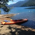 We rented a tandem kayak at the marina for 2 hours. We stopped at our site halfway through for a drink- Lake Crescent, Fairholme Campground