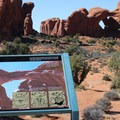 Information signage on the trail leading to Double Arch.- Double Arch