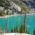 First view of Colchuck Lake as you enter the camp sites around the lake.- Colchuck Lake Trail