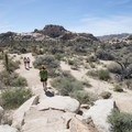 Hikers along the Barker Dam Hike.- Barker Dam Trail