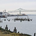 View west of the Astoria-Megler Bridge along the Astoria Riverwalk Trail.- Astoria Riverwalk Trail