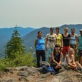Our full Oregon Wild hiking group poses for a photo at the viewpoint above Rooster Rock.- Rooster Rock Hike