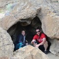 Contributors Alexa and Brent step into a cave at Fort Rock State Natural Area- Fort Rock State Natural Area