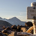 A sign marks the end of the 2.5 mile hike to the rim.  Middle & North Sister seen in the background.- Tam McArthur Rim Hike