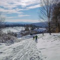View south towards the Von Trapp Lodge from the trails.- Trapp Family Lodge Cross-country Ski Center