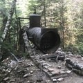 An old boiler and lots of scattered masonry- Opal Creek Hiking Trail