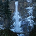 During a deep freeze, ice forms around the pillar of water- Multnomah Falls + Lodge
