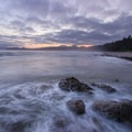 A cloudy sunrise as the tide slowly starts to recede- Point of the Arches via Shi Shi Beach