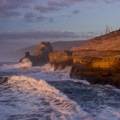 Evening light on the cape as large waves crash- Cape Kiwanda State Natural Area
