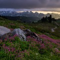 Clouds open up just enough for some light to shine on the Tatoosh Range while hiking along the Golden Gate Cutoff trail- Skyline Trail Hike