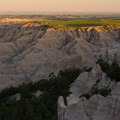 Green plains top the erosional formations of Badlands National Park- Badlands National Park