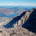 View into the crater and Mt Rainier in the distance from the rim- Mount St. Helens National Volcanic Monument