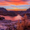 Vibrant sunrise over Perfection Lake with Prusik Peak to the left- Prusik Peak: West Ridge