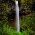 Lush greenery surrounds the falls in late spring.- Shellburg Falls Loop Hike