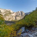 A dry Yosemite falls cradled by fall leaves- Four Mile Trail to Glacier Point