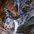 Ice Box Canyon falls, with a hiker pictured to give some perspective.- Ice Box Canyon
