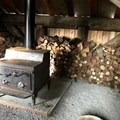 Stove and firewood in shelter - Mountain View Shelter Snowshoe