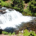 A large waterfall along the creek as you hike into the lakes- Green Lakes