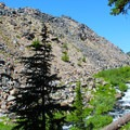 Basalt and obsidian deposited along the creek as you hike into the lakes- Green Lakes