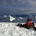 Enjoying a break, snack, and a view at the top- Mount St. Helens: Worm Flows Snowshoe