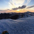 Mt Rainier (left) and Mt Adams (right) frame the spectacular sunrise- Mount St. Helens Worm Flows Hike