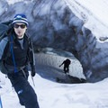 Climbing up through the top opening of Frozen Minotaur- Mount Hood: Sandy Glacier Ice Caves